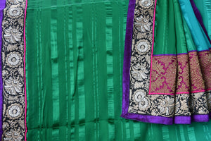 Buy green and blue shaded crepe saree with embroidered border and pink brocade pallu. Beautiful sari for casual parties.-details
