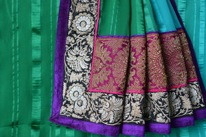 Buy green and blue shaded crepe saree with embroidered border and pink brocade pallu. Beautiful sari for casual parties.- brocade embroidered pallu