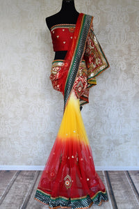 Shop red and yellow net saree online in USA with jewel pattern embroidery from Pure Elegance. Let your ethnic style be one of a kind with an exquisite variety of Indian handloom sarees, pure silk sarees, designer sarees from our exclusive fashion store in USA.-full view