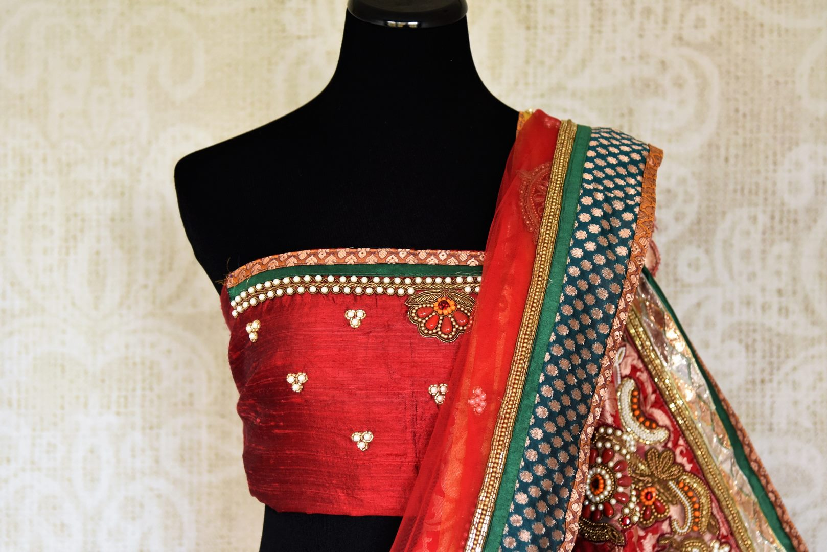 Shop red and yellow net saree online in USA with jewel pattern embroidery from Pure Elegance. Let your ethnic style be one of a kind with an exquisite variety of Indian handloom sarees, pure silk sarees, designer sarees from our exclusive fashion store in USA.-blouse pallu