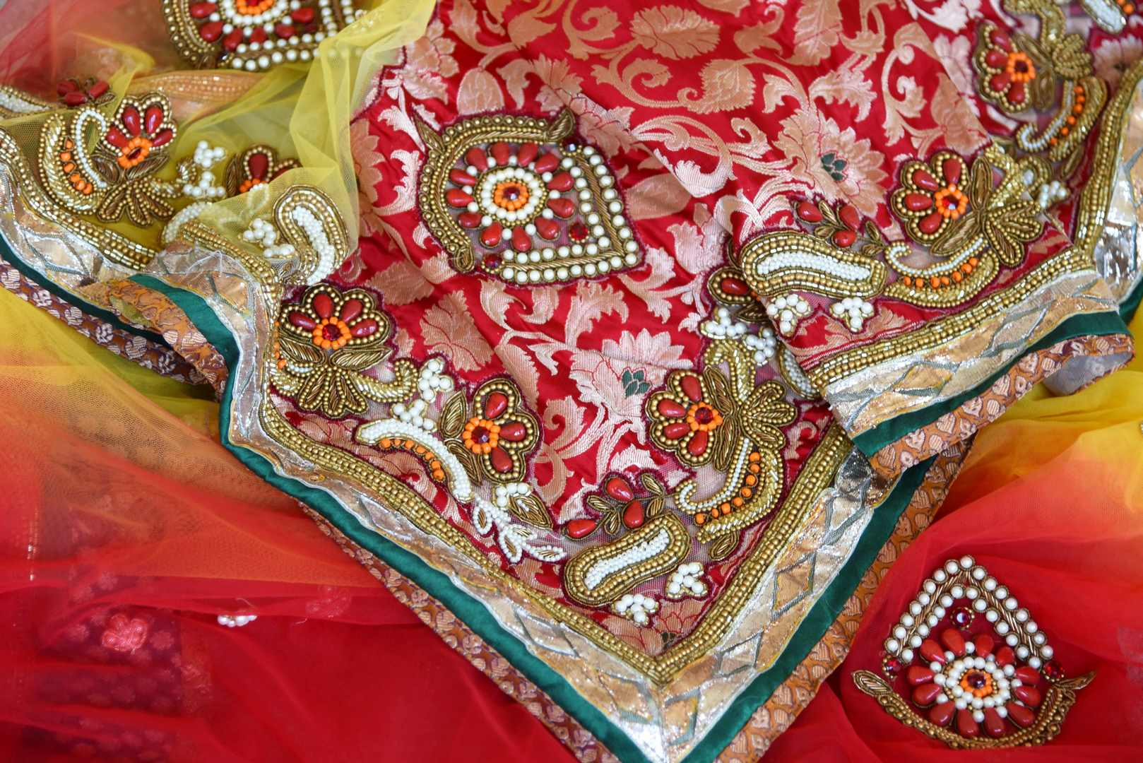 Shop red and yellow net saree online in USA with jewel pattern embroidery from Pure Elegance. Let your ethnic style be one of a kind with an exquisite variety of Indian handloom sarees, pure silk sarees, designer sarees from our exclusive fashion store in USA.-details
