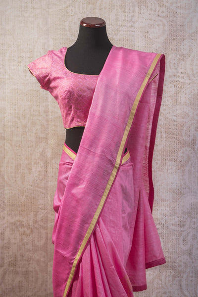 90b839 Matka silk saree with khari print and golden border. This pretty pink saree comes with stitched blouse and can be bought online at our ethnic wear store in USA and is versatile and great for many occasions.