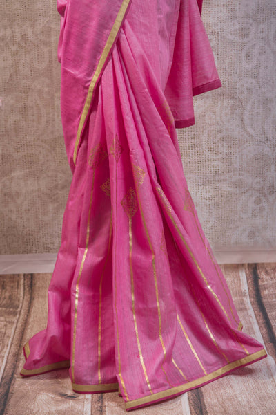 90b839 Traditional matka silk saree with khari print and golden border. This lovely pink saree comes with stitched blouse and can be bought online at our ethnic clothing store in USA. This saree will be a great addition to your Indian wear wardrobe.