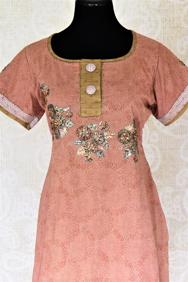 Buy dusty pink embroidered suit online in USA with dupatta. Choose from a beautiful range of Indian salwar suits, palazzo suits, sharara suits, Anarkali suits from Pure Elegance Indian fashion store in USA.-full view