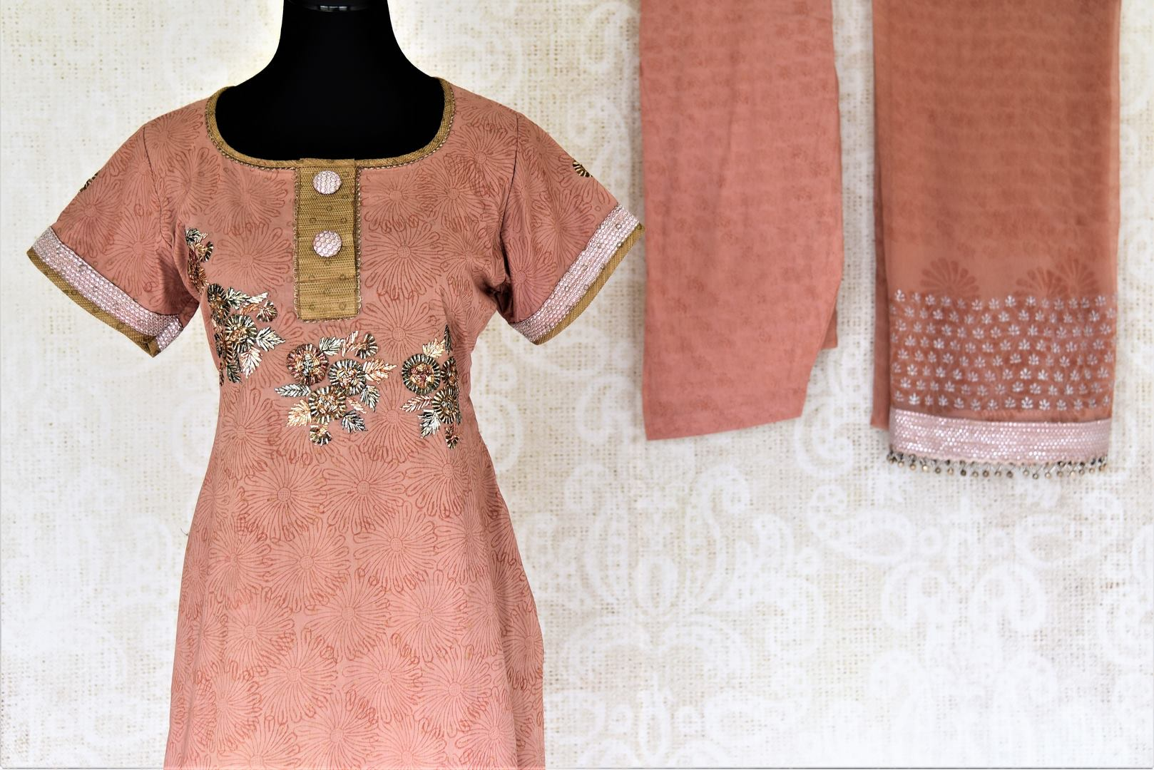 Buy dusty pink embroidered suit online in USA with dupatta. Choose from a beautiful range of Indian salwar suits, palazzo suits, sharara suits, Anarkali suits from Pure Elegance Indian fashion store in USA.-front