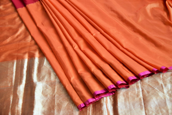 90B909  Red & orange traditional Banarasi silk saree online in USA at Pure Elegance. This Indian sari is an evergreen party wear saree or a bridesmaid saree and can be styled in very many ways!