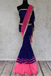 Buy dark blue georgette saree online in USA with pink embroidered net border from Pure Elegance. Let your ethnic style be one of a kind with an exquisite variety of Indian handloom sarees, pure silk sarees, designer sarees from our exclusive fashion store in USA.-full view