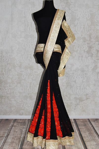 Shop black georgette saree online in USA with embroidered gold border from Pure Elegance. Let your ethnic style be one of a kind with an exquisite variety of Indian handloom sarees, pure silk sarees, designer sarees from our exclusive fashion store in USA.-full view