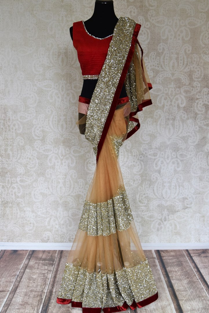 Shop beige embroidered net saree online in USA with red saree blouse from Pure Elegance. Let your ethnic style be one of a kind with an exquisite variety of Indian handloom sarees, pure silk sarees, Bollywood sarees from our exclusive fashion store in USA.-full view