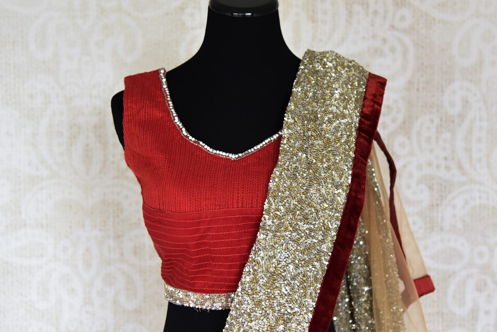 Shop beige embroidered net saree online in USA with red saree blouse from Pure Elegance. Let your ethnic style be one of a kind with an exquisite variety of Indian handloom sarees, pure silk sarees, Bollywood sarees from our exclusive fashion store in USA.-blouse pallu