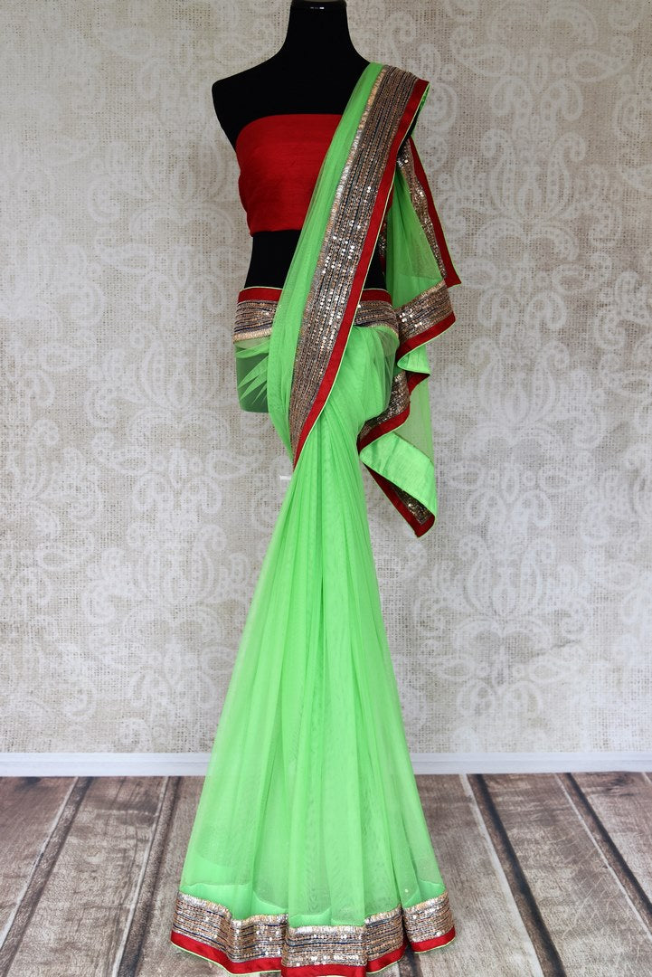 Shop parrot green net saree online in USA with embroidered border from Pure Elegance. Let your ethnic style be one of a kind with an exquisite variety of Indian handloom sarees, pure silk sarees, Bollywood sarees from our exclusive fashion store in USA.-full view