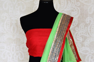 Shop parrot green net saree online in USA with embroidered border from Pure Elegance. Let your ethnic style be one of a kind with an exquisite variety of Indian handloom sarees, pure silk sarees, Bollywood sarees from our exclusive fashion store in USA.-blouse pallu