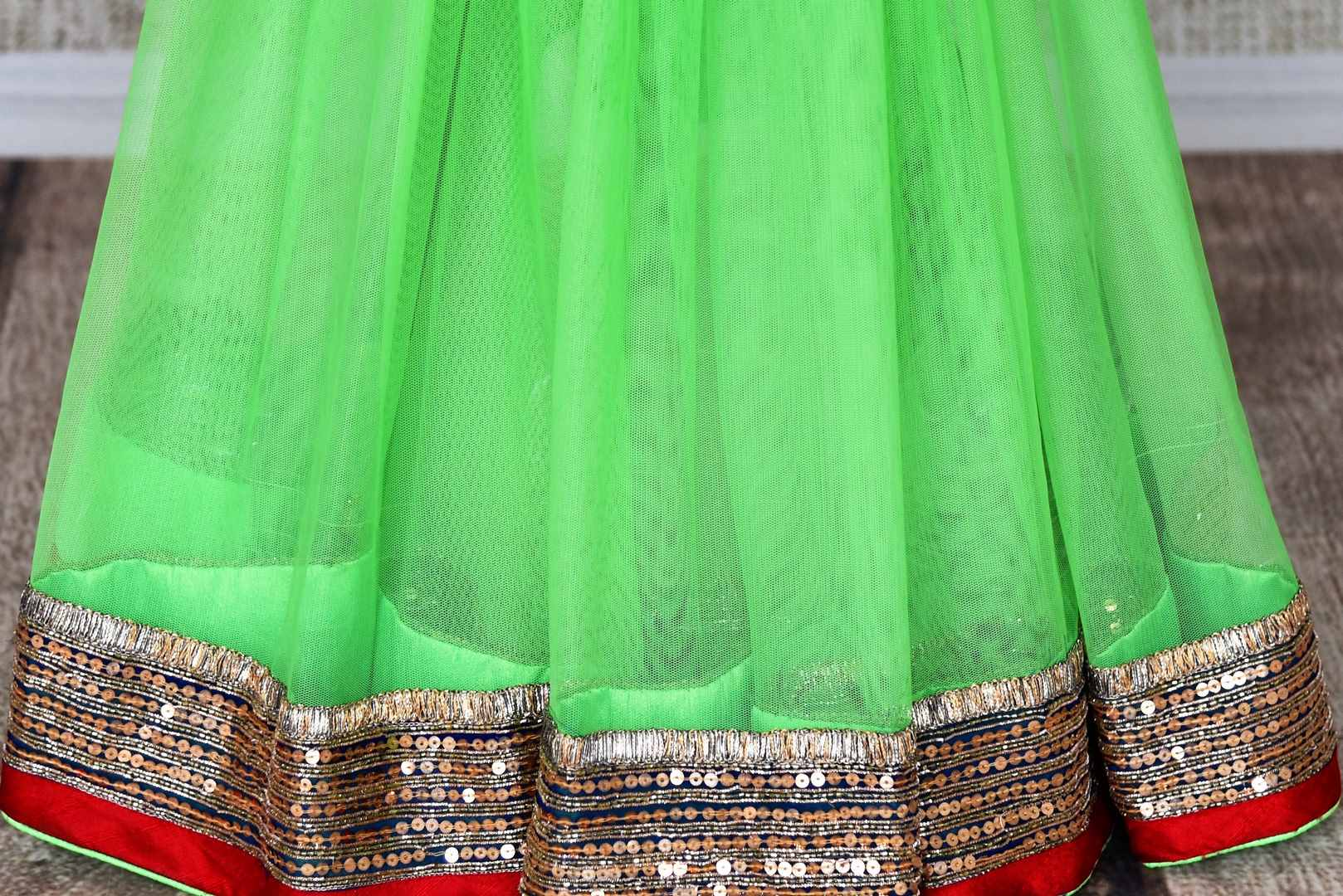 Shop parrot green net saree online in USA with embroidered border from Pure Elegance. Let your ethnic style be one of a kind with an exquisite variety of Indian handloom sarees, pure silk sarees, Bollywood sarees from our exclusive fashion store in USA.-pleats