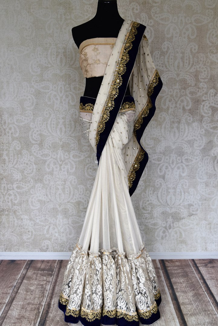 Shop off-white shimmer saree online in USA with net embroidered border from Pure Elegance. Let your ethnic style be one of a kind with an exquisite variety of Indian handloom sarees, pure silk sarees, Bollywood sarees from our exclusive fashion store in USA.-full view