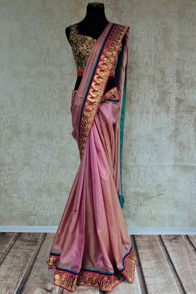90B972 Eye-catching shimmer pink saree with pops of blue. The exquisite silk party wear saree available online at Pure Elegance will be a lovely addition to your ethnic wear wardrobe. This sari is sure to make a gorgeous and bold statement wherever you go.