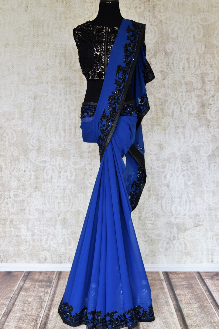 Buy dark blue hand work georgette sari online in USA with black blouse. Elevate your traditional style with exquisite Indian designer sarees from Pure Elegance Indian clothing store in USA. Explore a range of stunning silk sarees, embroidered sarees, wedding sarees especially from India for women in USA.-full view