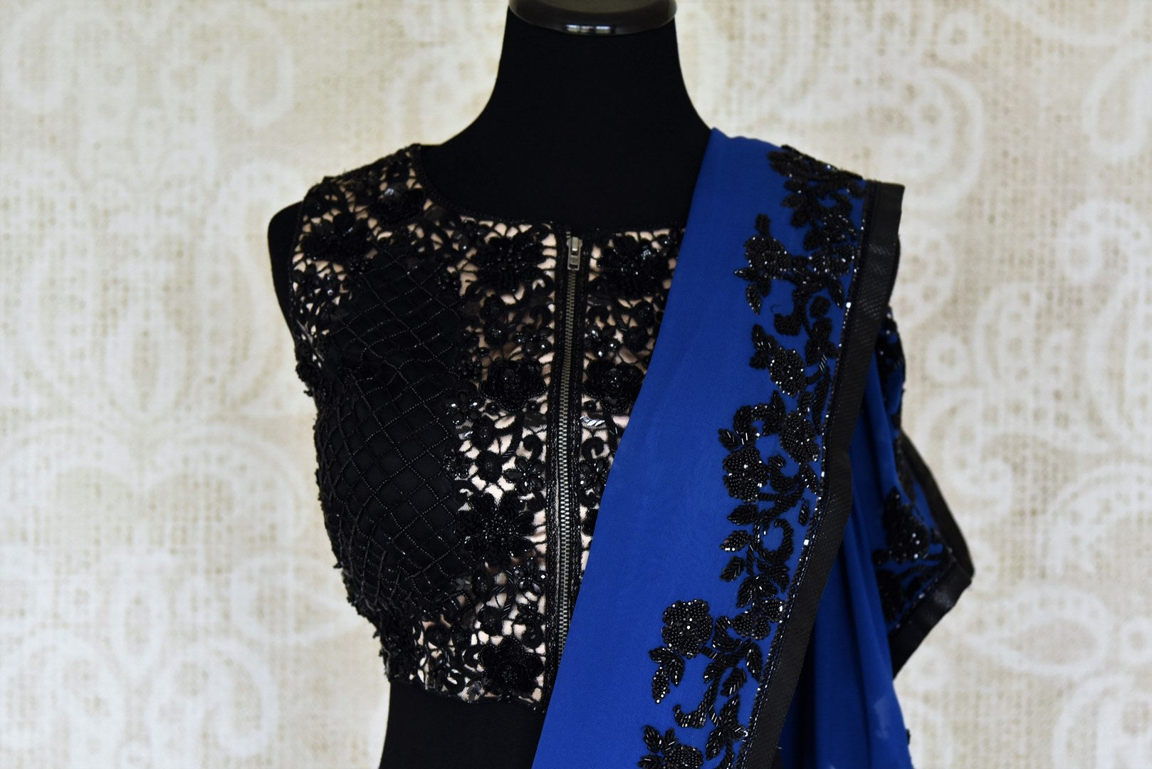 Buy dark blue hand work georgette sari online in USA with black blouse. Elevate your traditional style with exquisite Indian designer sarees from Pure Elegance Indian clothing store in USA. Explore a range of stunning silk sarees, embroidered sarees, wedding sarees especially from India for women in USA.-blouse pallu