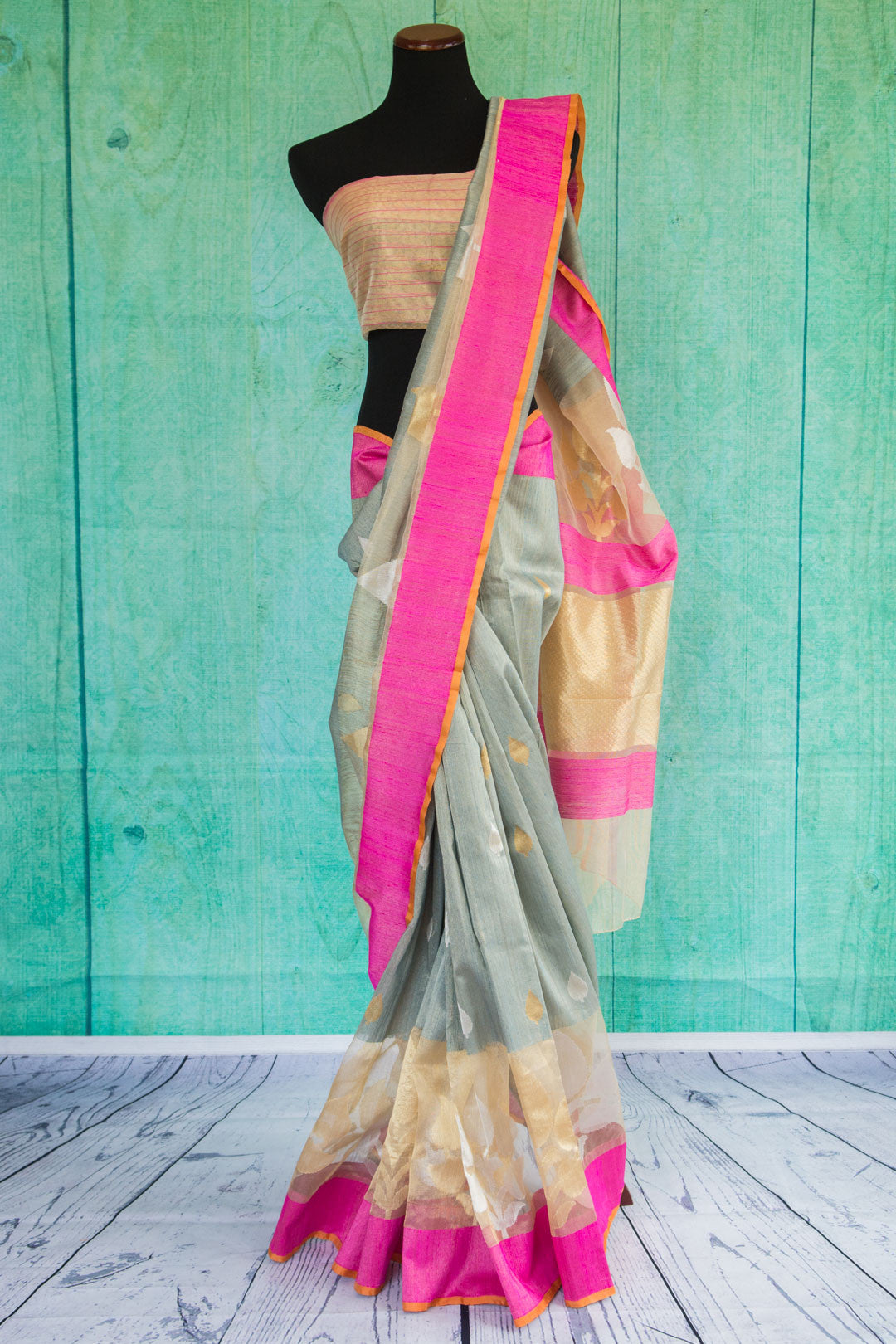 Beautiful mix of pale colors with bright pink border in stunning casual tissue silk saree.-Full view