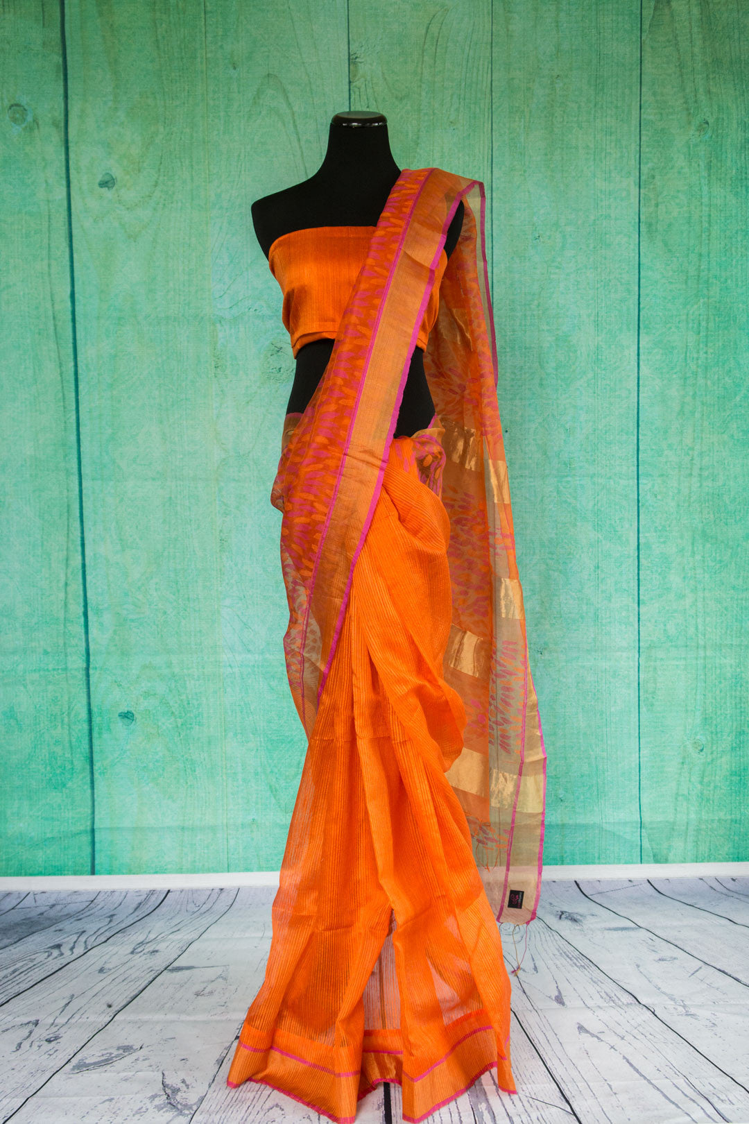 90c009 Orange matka silk saree with a golden border with pink trim. Buy this traditional saree, ideal for festive occasions at Pure Elegance, our Indian clothing store online in USA.