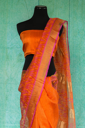90c009 Orange saree with a golden border with pink trim. This traditional matka silk saree, ideal for festive occasions at Pure Elegance, is a classic!