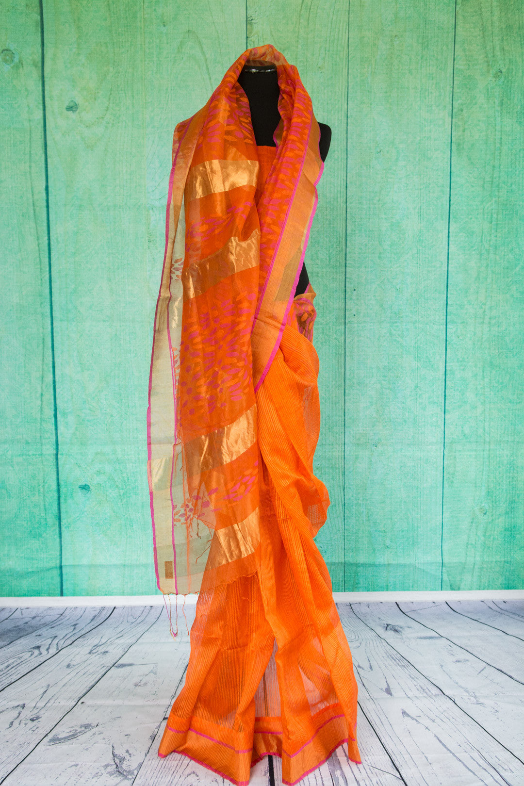90c009 Orange matka silk saree with a golden border with pink trim. Buy this ethnic saree at our store Pure Elegance in USA. This wonderfully versatile saree is a must-have this season!