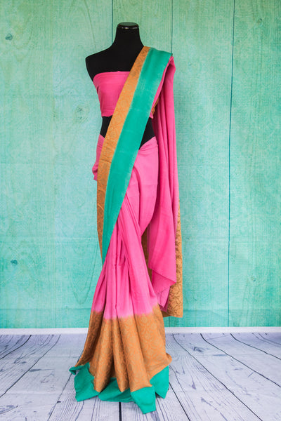 90c028 Pink sari with pops of orange & blue at the border. The traditional woven sari from Banaras available at our ethnic wear store makes for the perfect festive and party wear Indian outfit.