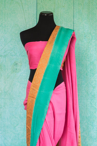 90c028 Simple pink sari from Banaras with pops of orange & blue at the border. The traditional woven sari can be bought online in USA at our ethnic wear store makes for the perfect festive and party wear Indian outfit.