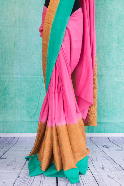 90c028 Vibrant pink sari with pops of orange & blue at the border. The traditional woven sari from Banaras makes for the perfect festive and party wear Indian outfit. Buy it at Pure Elegance.