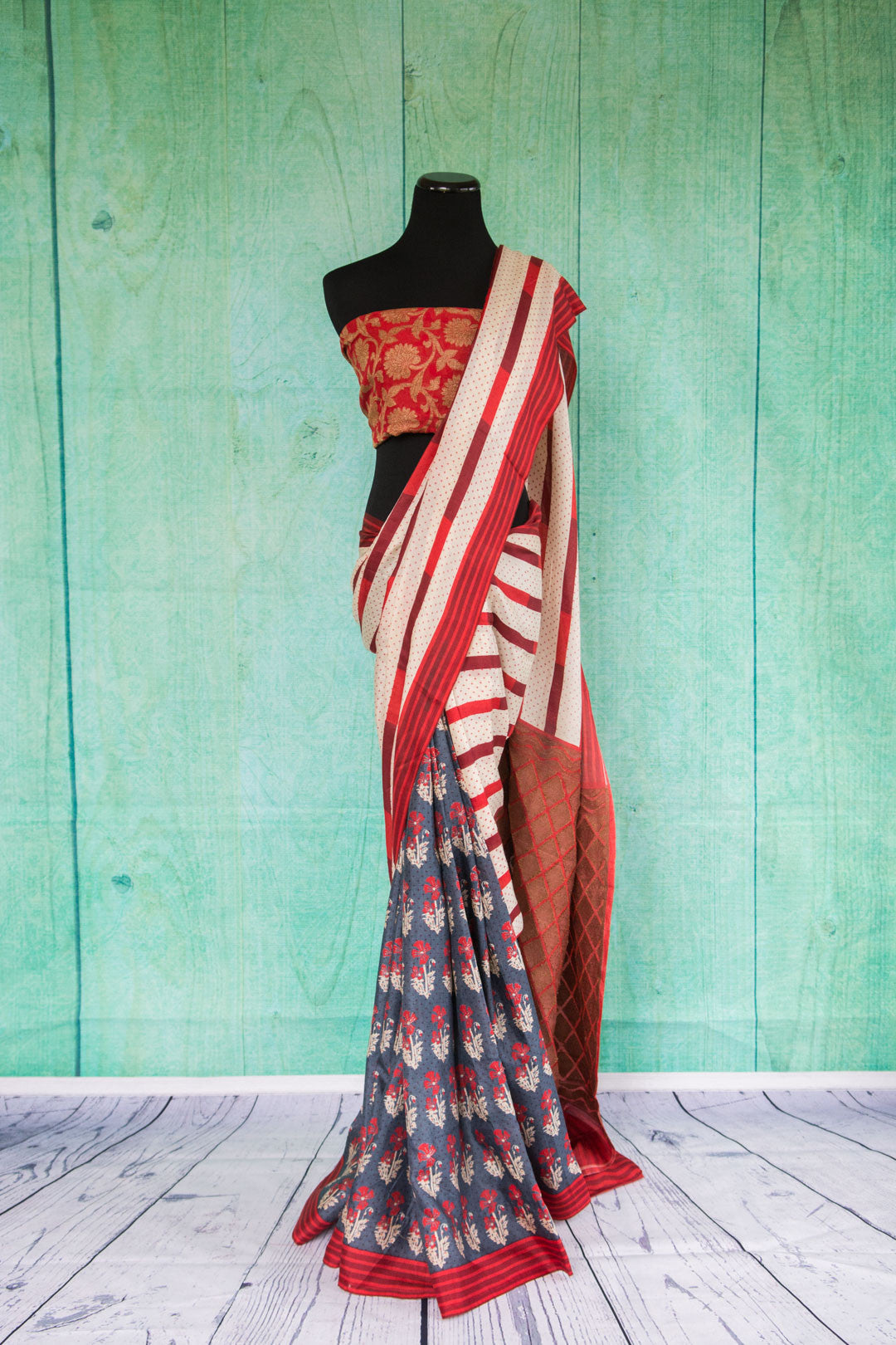 90c033Half & half, striped & floral saree. The red, white and blue woven saree from Banaras makes for a bold party wear Indian outfit & is available at our store Pure Elegance online and in our store in Edison, USA.
