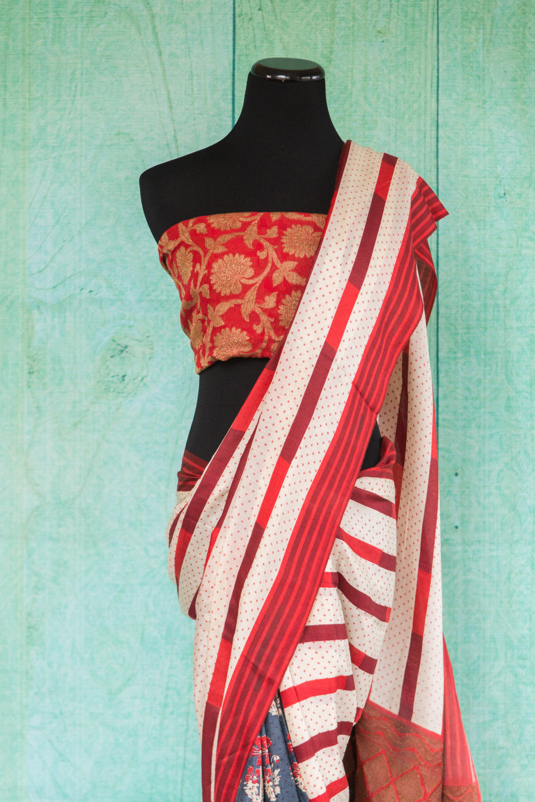 90c033Half striped & half floral saree online in USA at Pure Elegance. The red, white and blue woven saree from Banaras makes for a bold party wear Indian outfit.