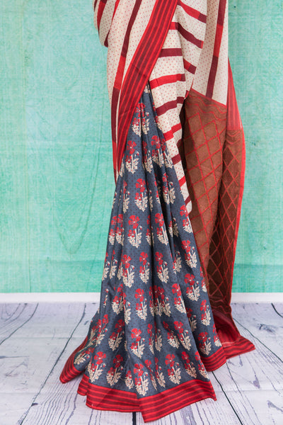 90c033 This striped & floral saree comes in red, white and blue hues. The half and half woven saree from Banaras makes for a striking party wear Indian outfit & is available at our store Pure Elegance online and in our store in Edison, USA.