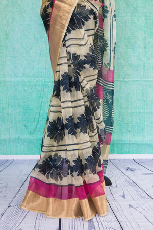 90c081 Printed black and white sari with a golden border and pink blouse. The zari kota saree from India online in USA is ideal for parties, as well as festive Indian occasions. Buy this ethnic saree online at our Indian clothing store.