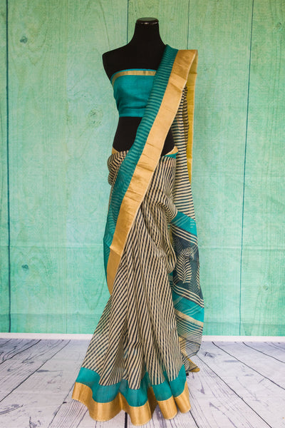 90c085 Black and cream striped zari kota saree with pops of blue and golden. Buy this printed party wear saree online at our Indian clothing store online in USA. The beautiful sari is sure to flutter hearts!