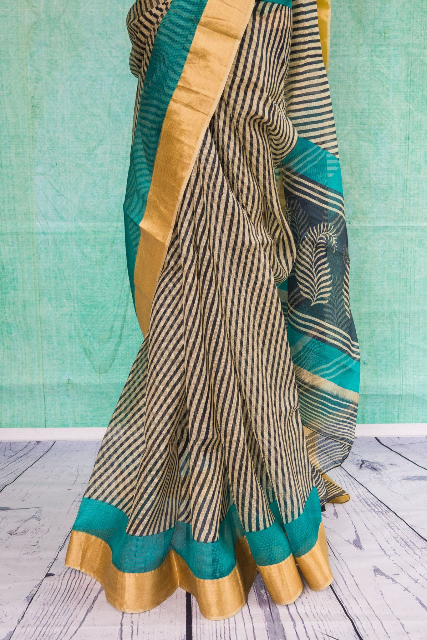 90c085 Black and cream striped zari kota saree with a blue and golden border trim and blue blouse piece. Buy this printed party wear saree online at our ethnic wear store in USA. The beautiful sari is sure to flutter hearts!