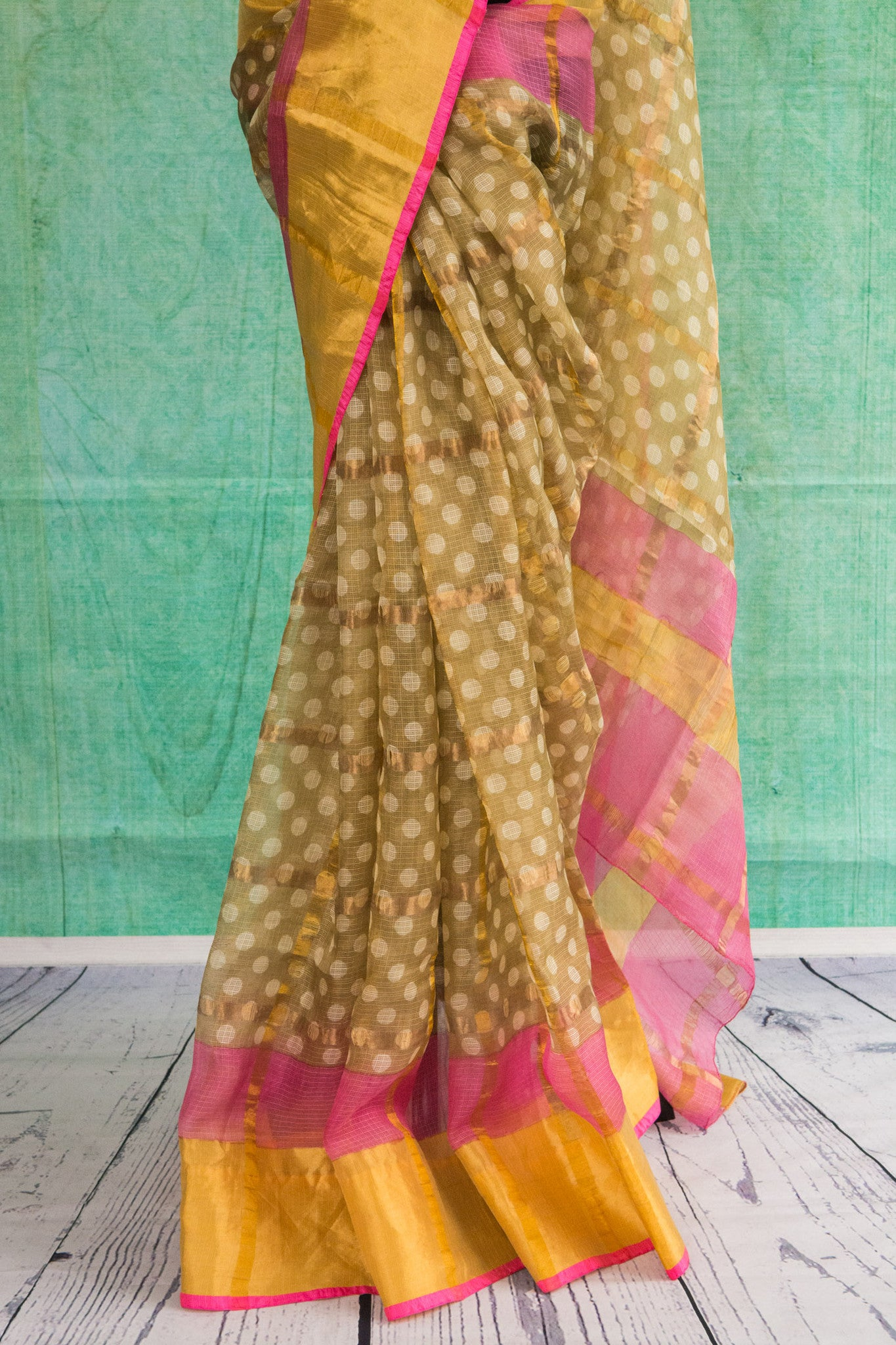 90c087 Traditional printed zari kota saree available at our Indian wear store in USA. The yellow saree with pops of pink and gold is perfect for pujas and festive occasions. Buy this polka dotted saree at Pure Elegance.