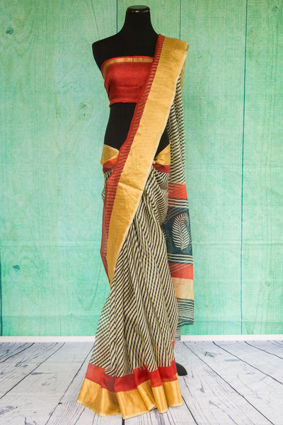 90c088 Traditional Printed Zari Kota saree with black and white stripes and gold and red trim. This beautiful saree, available online in USA, also comes with an un-stitched red blouse piece.