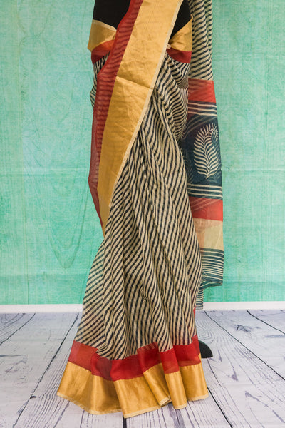 90c088 Traditional Zari Kota saree with black and white stripes and gold and red trim.  Buy this printed saree online in USA at Pure Elegance. The beautiful saree also comes with an un-stitched red blouse piece.