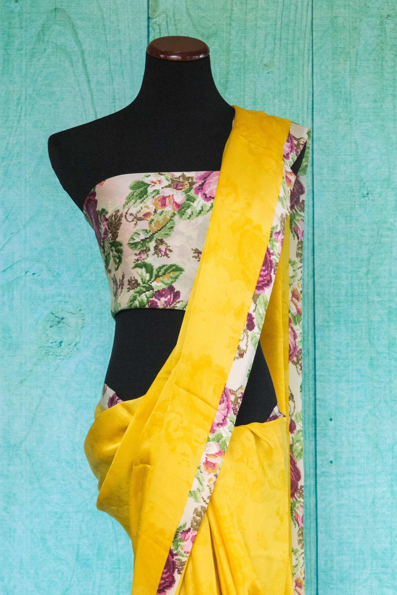90c092 Yellow saree with a multi colored floral blouse and border trim ideal for festivities. Buy this satin crepe plain saree online in USA at our Indian fashion store Pure Elegance