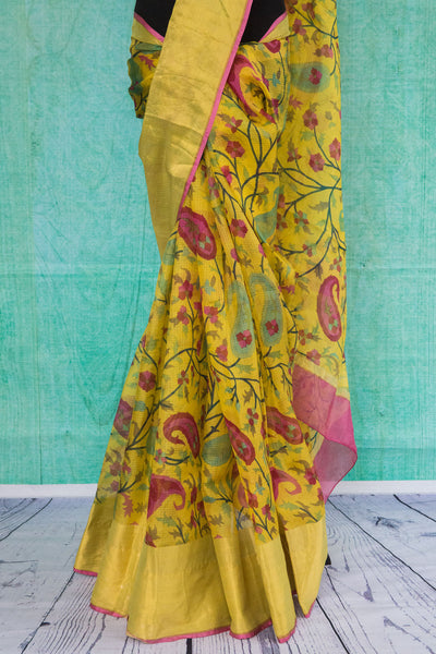 90c101 Floral saree that makes for a classic, traditional ethnic outfit, available at Pure Elegance - our Indian clothing store in USA. The yellow pink zari kota saree is ideal for pujas and festivals and celebratory occasions.