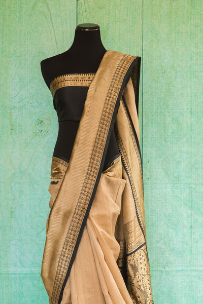 90c120 Sophisticated gold and black woven saree from Banaras. Buy this party wear saree at our Indian fashion store - Pure Elegance online and in Edison, New Jersey.