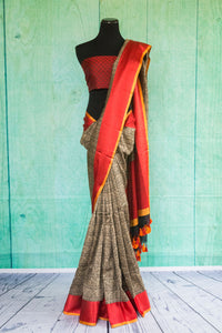 90c123 Traditional Indian woven saree from Banaras. The grey saree online in USA, with red border and red blouse is a classic pick for your Indian wear wardrobe.