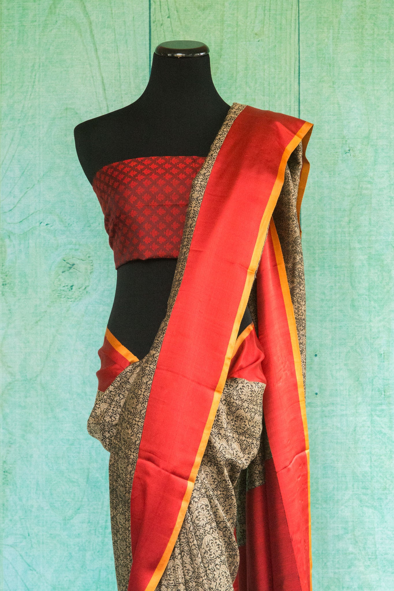 90c123 Buy this traditional woven saree from Banaras online in USA. The grey saree with red border and red blouse is an evergreen pick for your Indian clothing collection.
