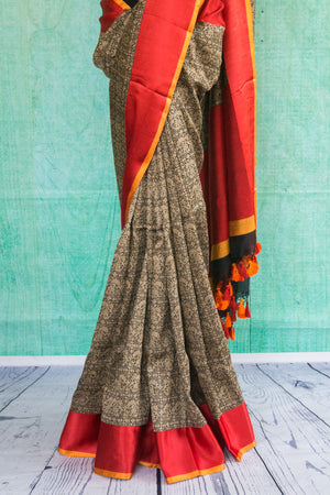 90c123 Traditional woven saree from Banaras. The grey saree, online in USA at Pure Elegance - our Indian wear store, with red border and red blouse is an evergreen pick for your Indian clothing collection.