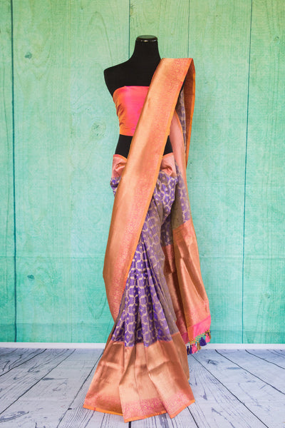 90c124 - Purple and pink traditional Indian saree available at our Indian clothing store in USA - Pure Elegance. The woven sari from Banaras is a classic Indian outfit that's ideal for wedding functions and festive occasions.