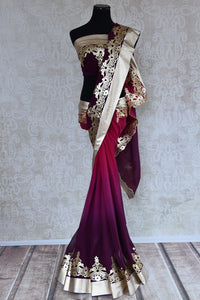 90C200 Shaded purple and wine red saree with exquisite leather work. The georgette party wear saree from India can be bought at our ethnic clothing store in USA. This one is a spectacular saree for all seasons!