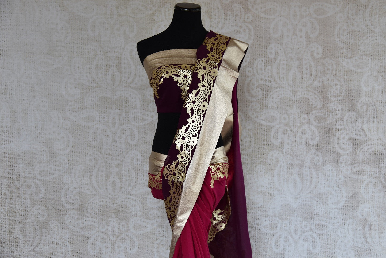 90c200 Get ready to turn heads and flutter hearts in this lovely shaded purple and wine red saree with exquisite leather work. The georgette party wear saree from India can be bought at our ethnic clothing store in USA.