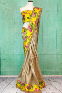 90C206 Charming dull gold saree with a delightful yellow floral border and blouse. Buy this alluring saree from Indian, online in USA at Pure Elegance - our ethnic clothing store.