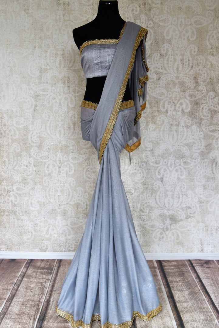 Buy grey shimmer saree online in USA with gold embroidered border from Pure Elegance. Let your ethnic style be one of a kind with an exquisite variety of Indian handloom sarees, pure silk sarees, Bollywood sarees from our exclusive fashion store in USA.-full view