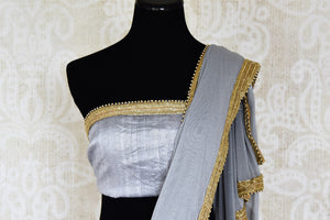 Buy grey shimmer saree online in USA with gold embroidered border from Pure Elegance. Let your ethnic style be one of a kind with an exquisite variety of Indian handloom sarees, pure silk sarees, Bollywood sarees from our exclusive fashion store in USA.-blouse pallu