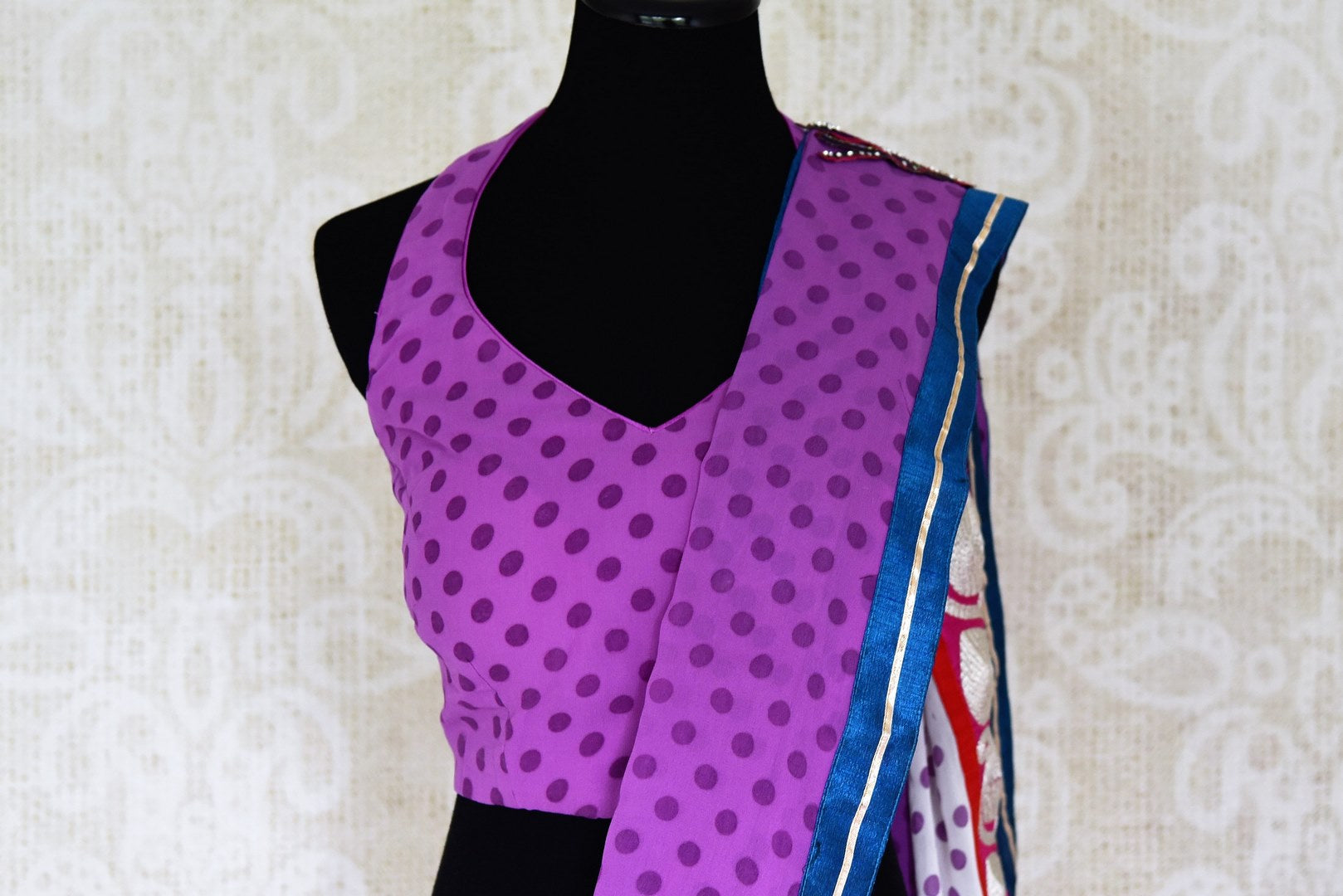 Buy purple and white polka dot georgette saree online in USA with embroidery. Shop the latest designer saris for weddings and special occasions from Pure Elegance Indian clothing store in USA.-blouse pallu
